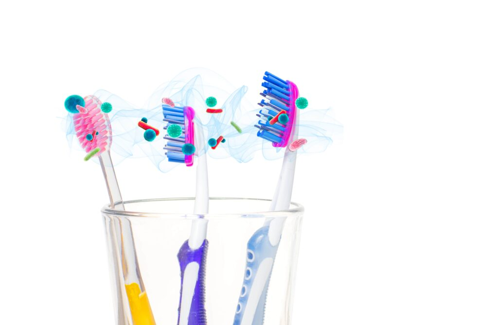 multiple toothbrushes in same cup with airborne bacteria