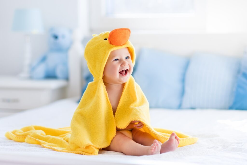 happy baby in a duck costume