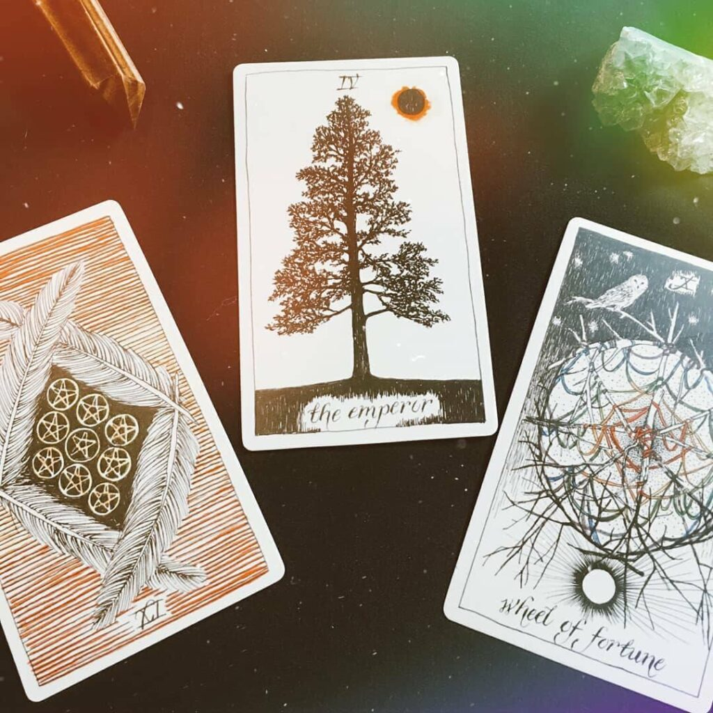 It can be confusing to know where to start with tarot cards. Here's a beginner's guide to tarot cards, plus a free guide to tarot spreads for beginners! #tarotcards #tarotspreads #tarotguide #freeprintable #magic #witchy #wicca