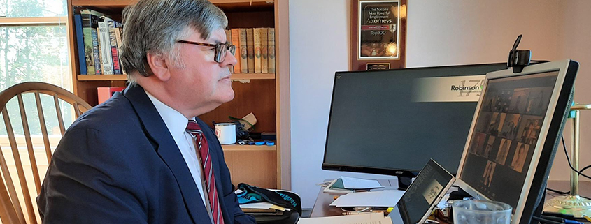 Matthew Miklave sitting at a computer Personal Consultation