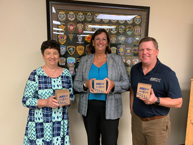 Alzheimer's Project, Debbie Moroney, Capt. Carey Love, and Scent Evidence K9 CEO, Paul Coley Bringing The Lost Home Project Scent Kits Seminole County Sheriff's Office