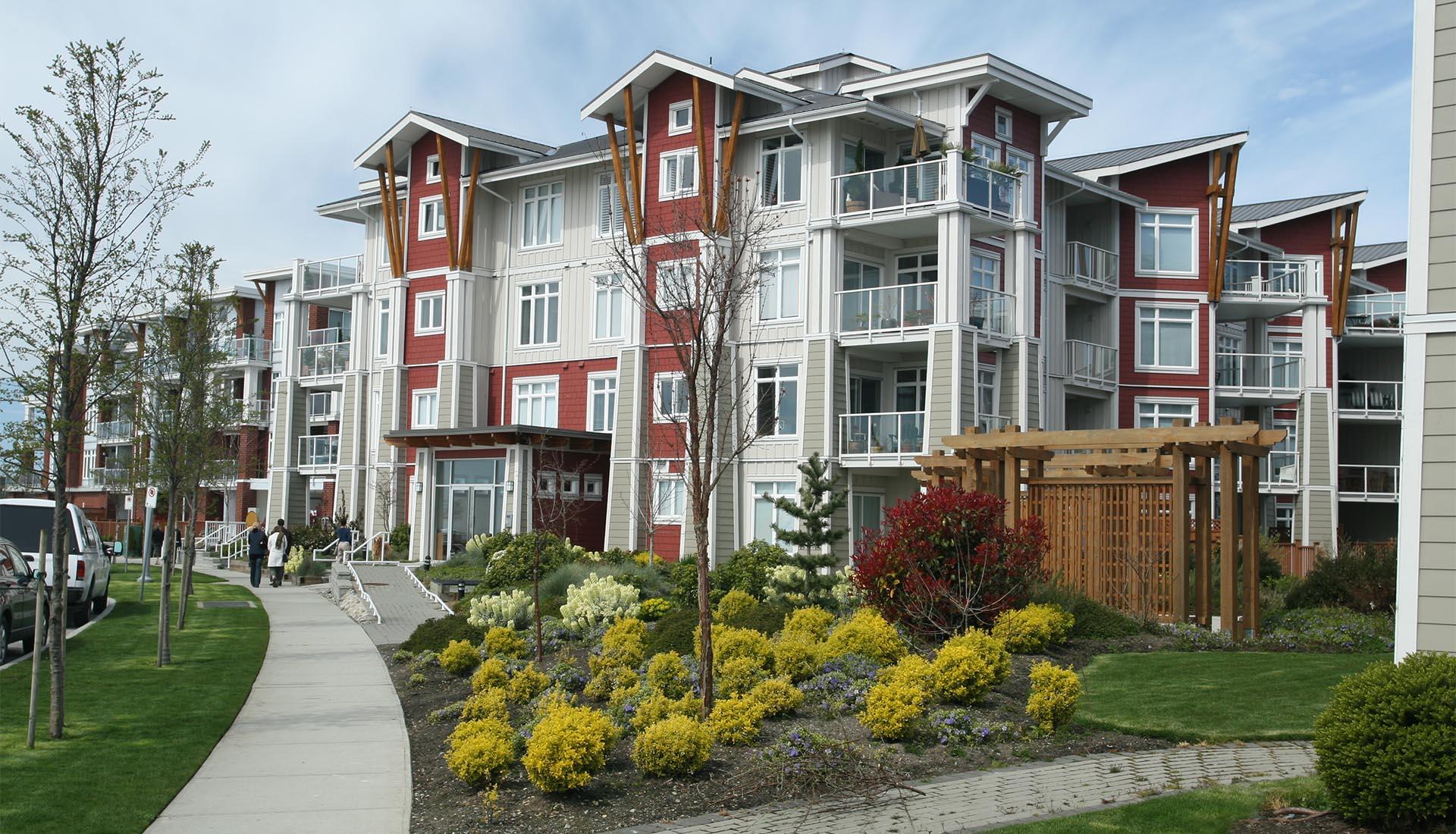 Newly constructed condominium building in suburban setting.