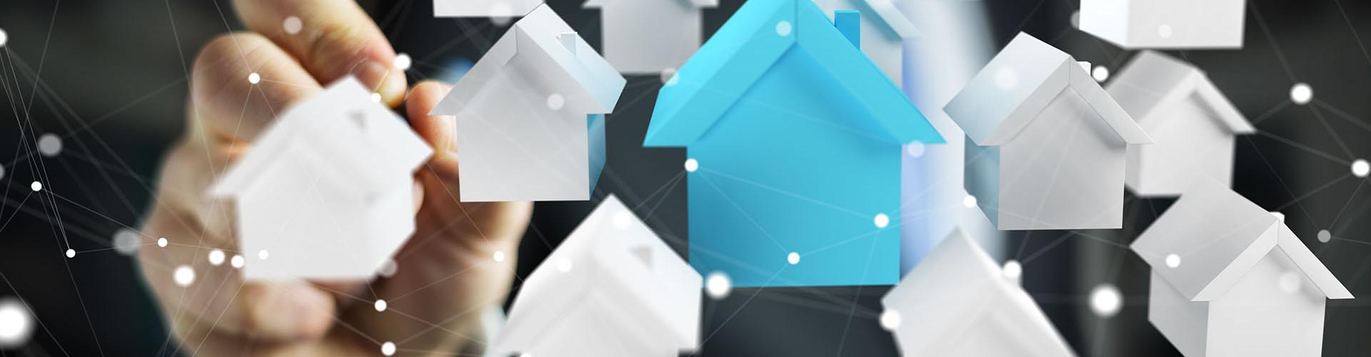 Businessman on blurred background using 3D rendered small white and blue houses