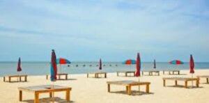 beach tables with umbrellas