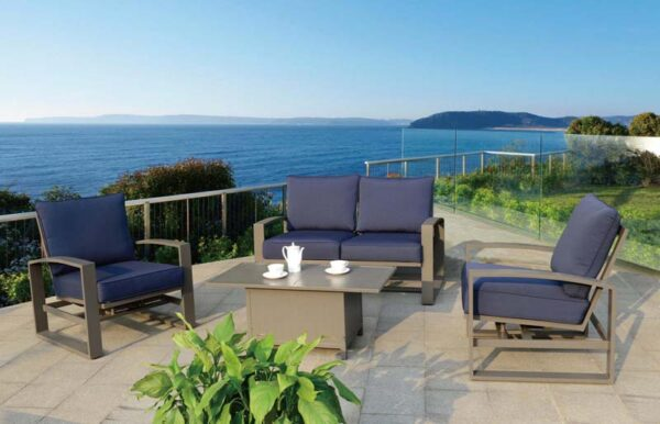 Atlantis Furniture Set on an outdoor patio with a view of the ocean