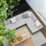 Magic Box sectional aerial view on a patio with a tree