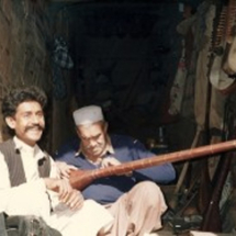 in-front-of-a-music-shop-in-the-old-part-of-peshawar-pakistan