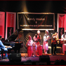 Pianist Randy Weston playing with Gnawa musician Abdellah El Gourd (far right) in Tangier, Morocco, at Performing Tangier 2008.