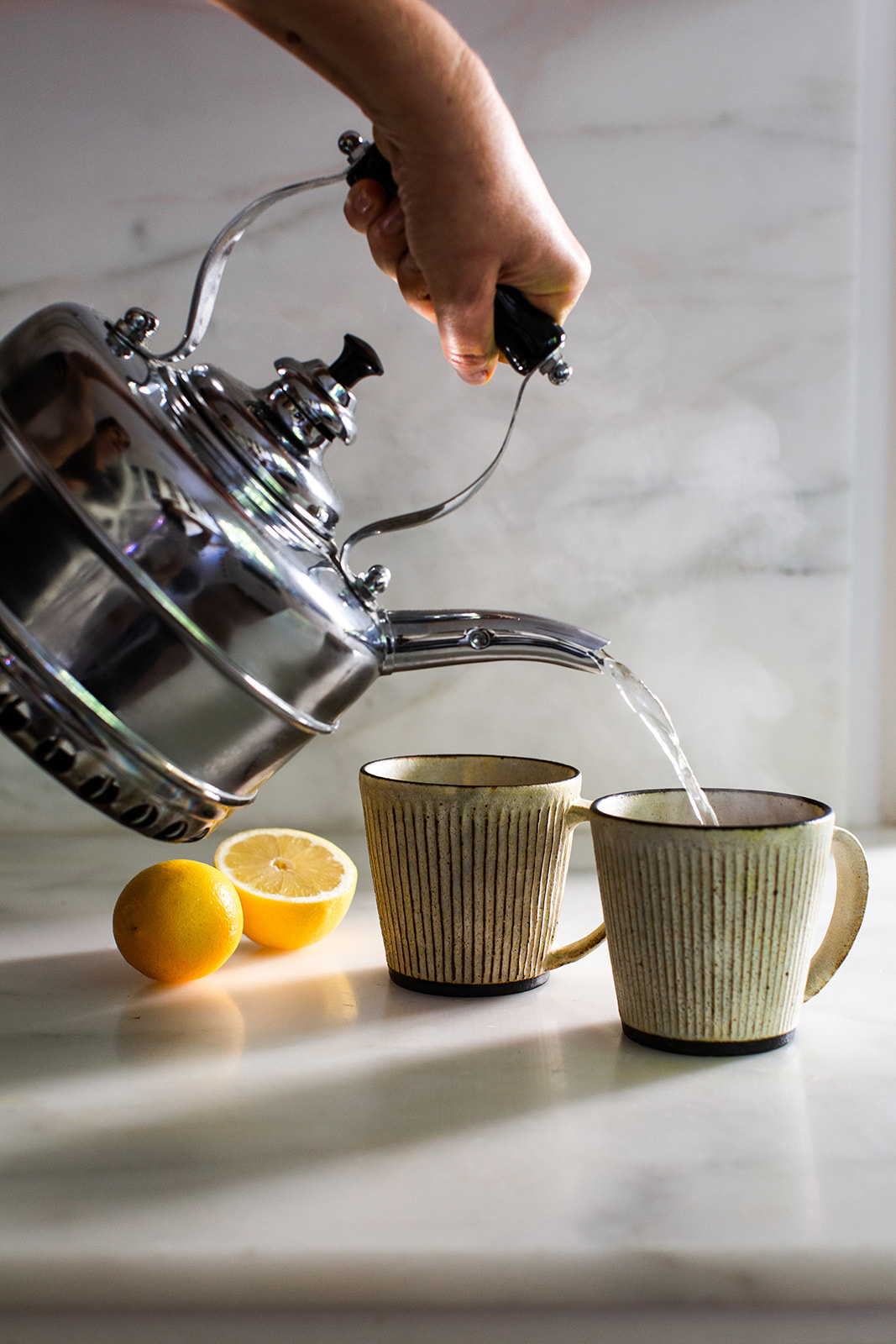 pouring tea into teacups