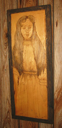 Woodburning, carving and staining