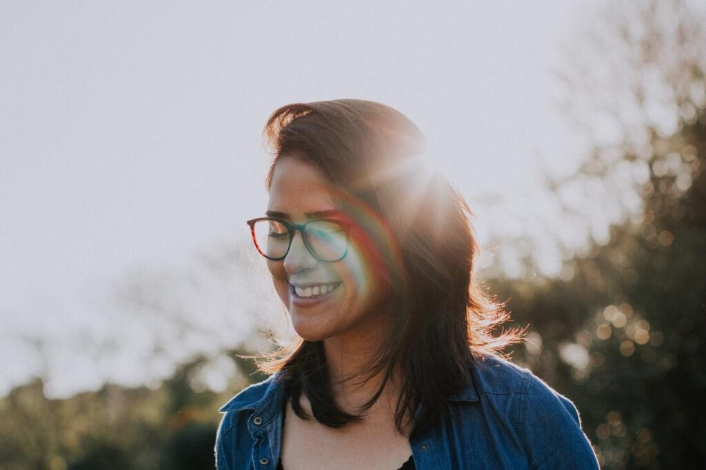 Woman smiles because she received chiropractic care for anxiety.