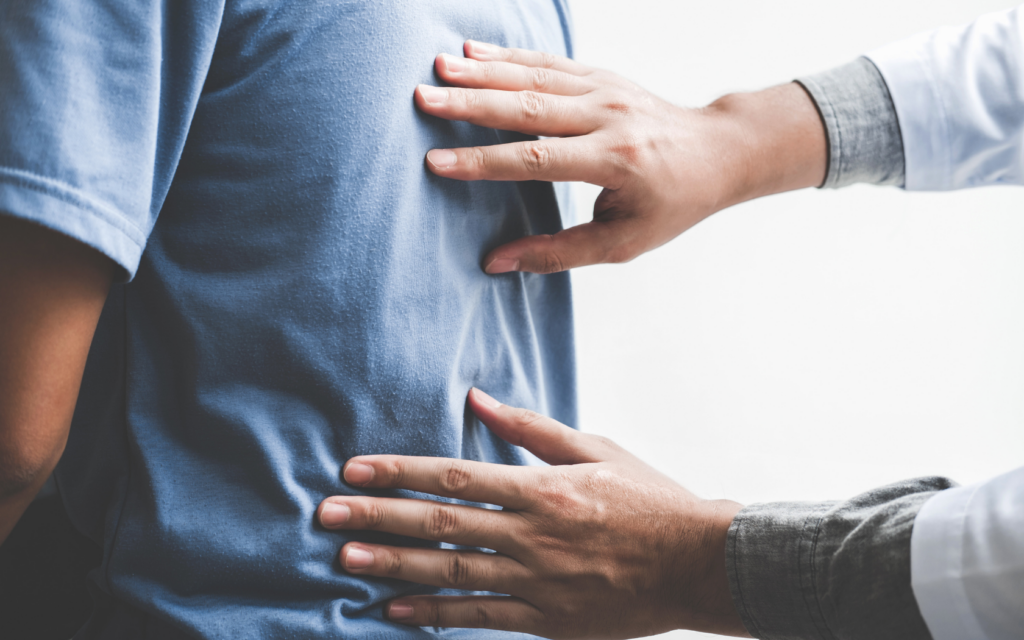 Patient sees chiropractor for posture correction.