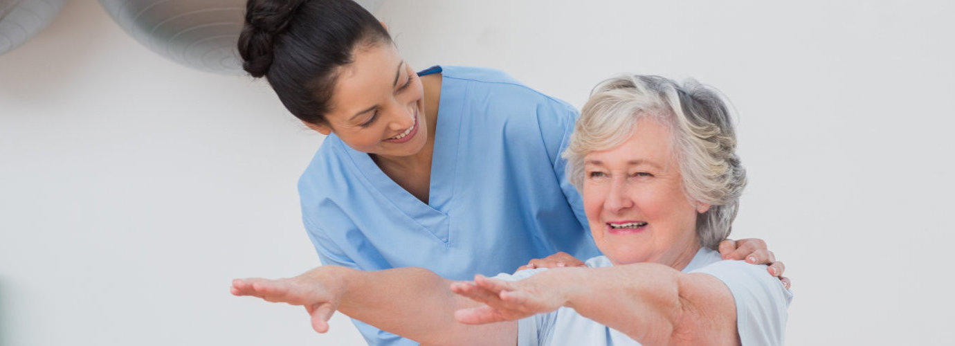 caregiver conducting physical therapy