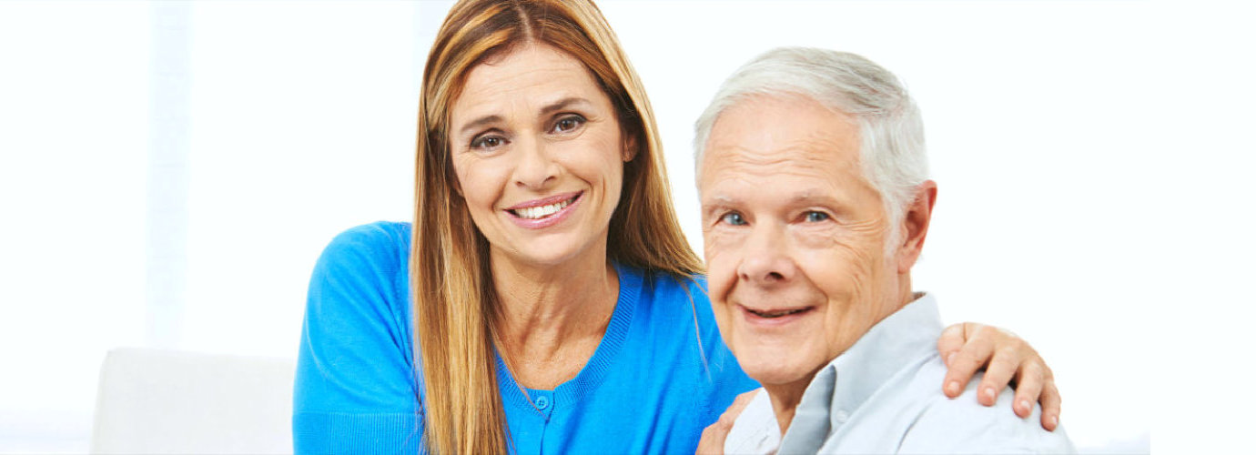 caregiver assisting senior man to eat