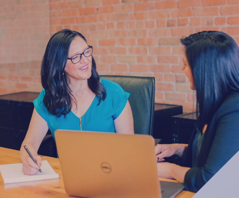 Two women in a discussion at an office table