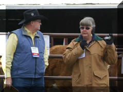 Debbie explaining their program & what cattle they would be looking at with MC Rick Thompson