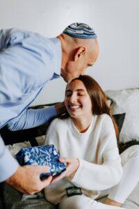 Jewish man kissing daughter