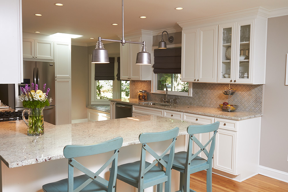 Kitchen with bar and barstools