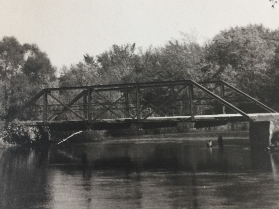 Photo of the Custer Road Bridge over the river