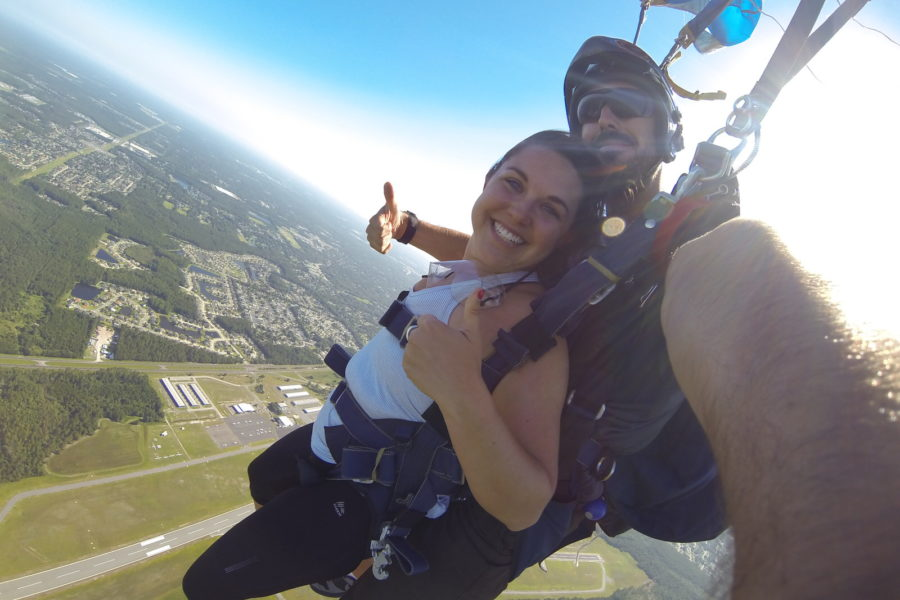 tandem skydiver smiles under canopy