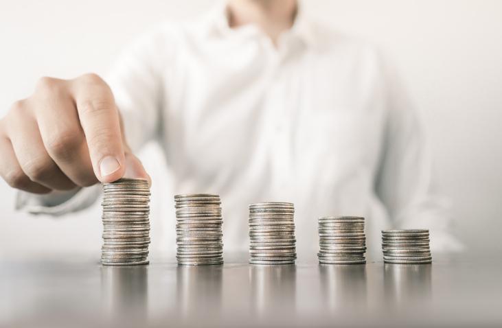 Man stacking coins