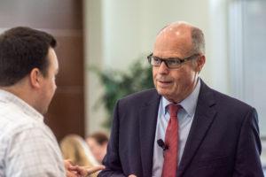 Image: Richard M. Bowen talking with a conference participant.