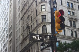 Image: Wall street building behind street light.