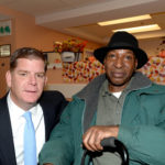 Mayor Walsh posing with a participant from 125A