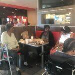 Participants sharing lunch at Burger King