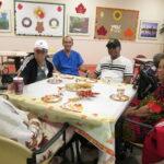 Participants enjoying tea and cookies