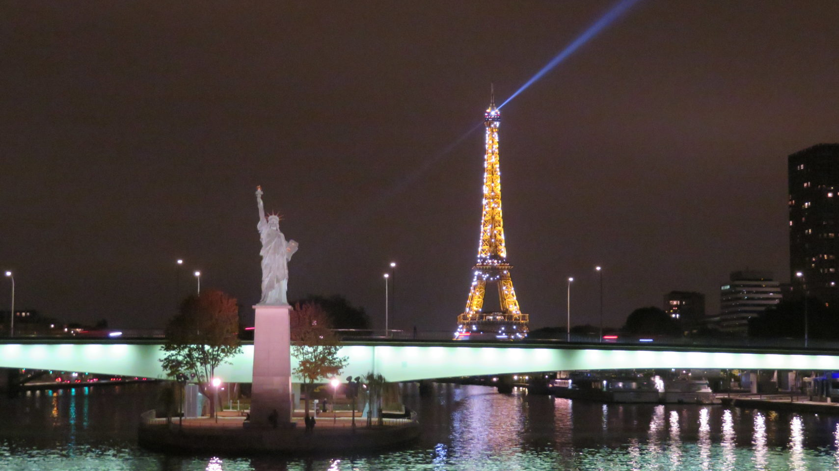 Statue of Liberty and Eiffel Tower at night in Paris, France (Paris and Normandie AMAWaterways Cruise)