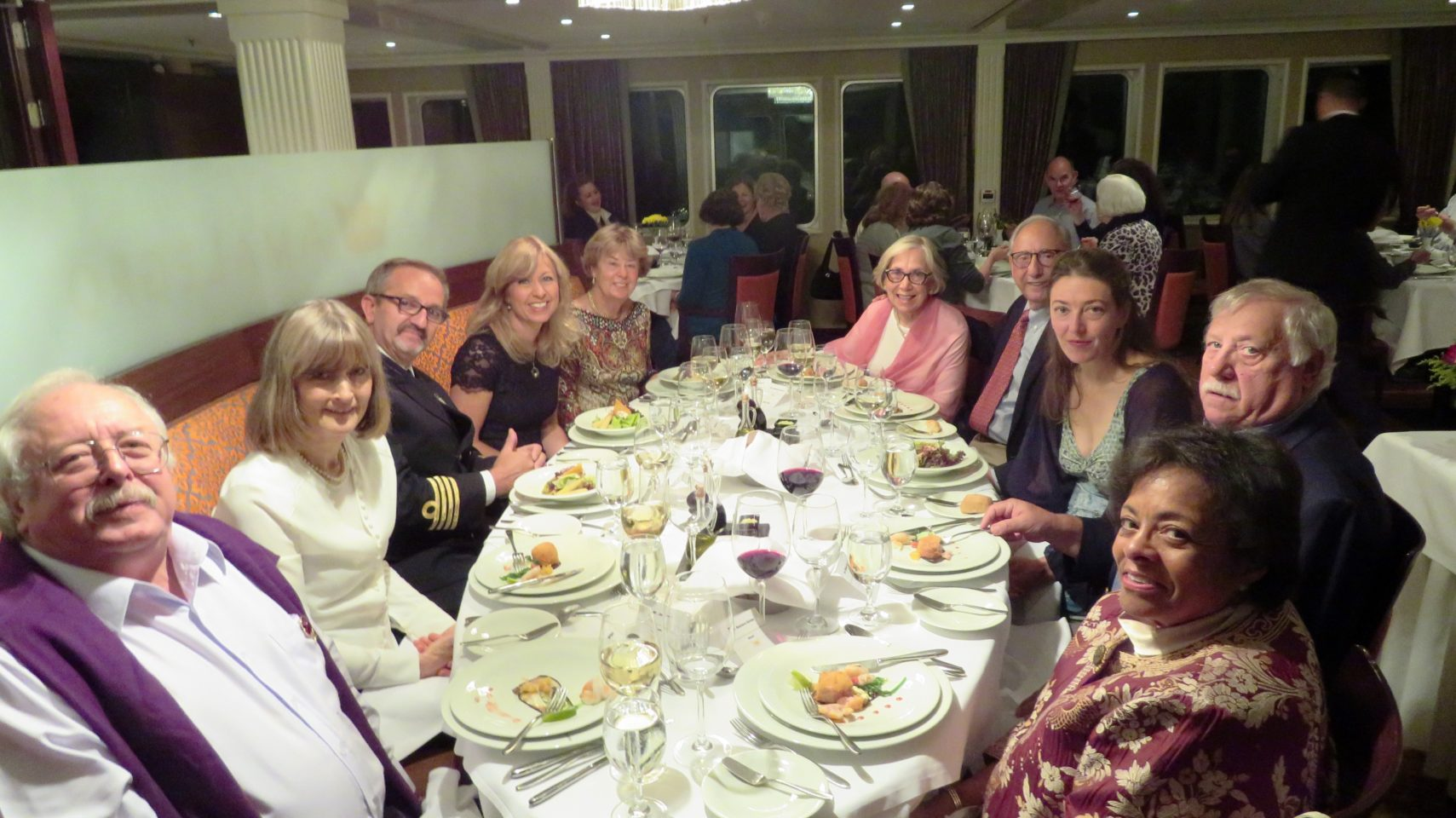 The Captain and his very special guests at the Captain's Table at dinnertime on the AMALegro (Paris and Normandie AMAWaterways Cruise)