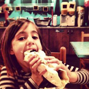 Girl Eating at Blue Coast
