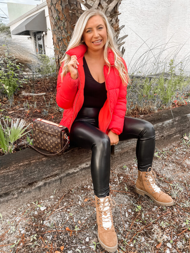 The cutest bodysuit paired with faux leather spanx leggings. Paired with a red puffer coat.
