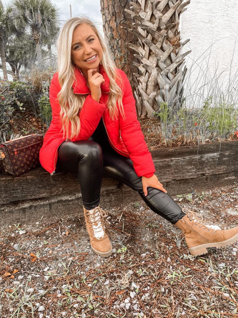 A puffer coat for winter fashion 2020. Red puffer coat and a pair of spanx faux leather leggings paired with Target boots.