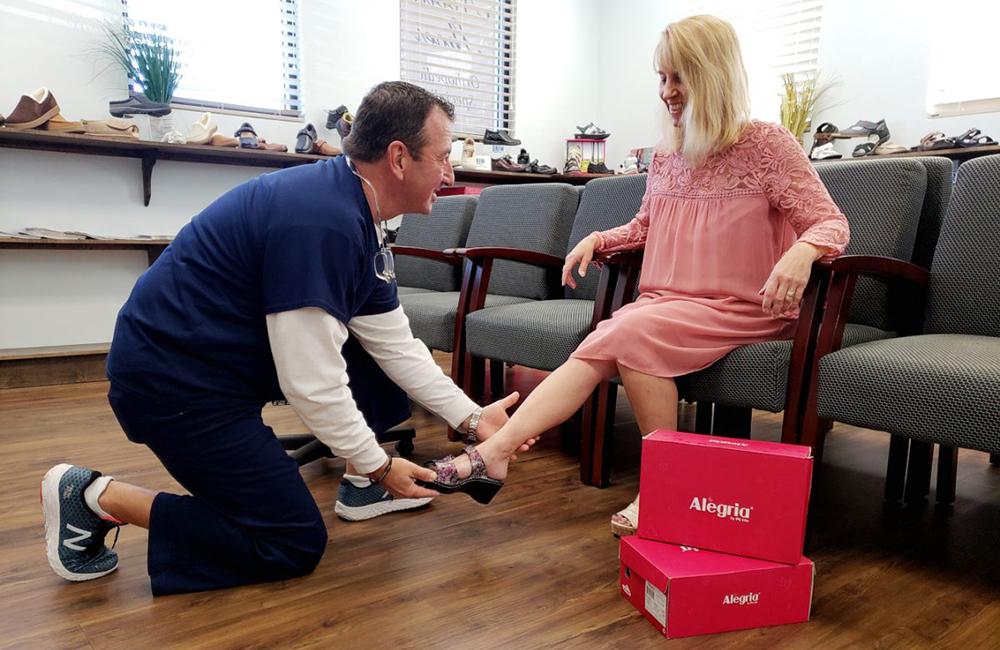 Dan Nobile assists customer at Nobile Shoes, Stuart Florida