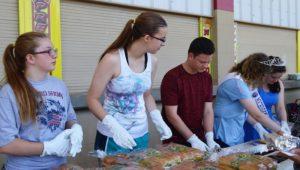 Teens serving lunch