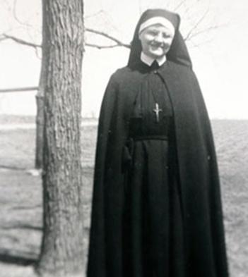 A nun smiling