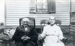 An old couple on rocking chairs