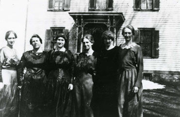 A group of women in a black and white photo