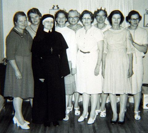 Women next to a nun