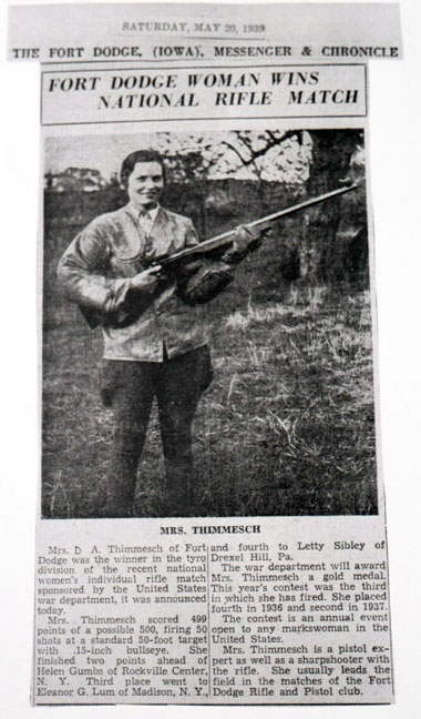 A woman holding a rifle in the newspaper
