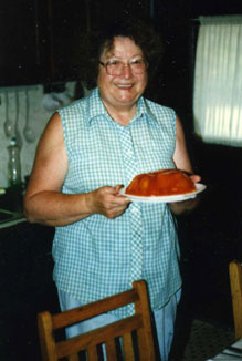 A woman carrying food to the table