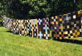 Quilts hanging under the sun