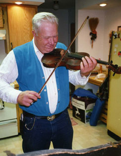 An old man playing a violin