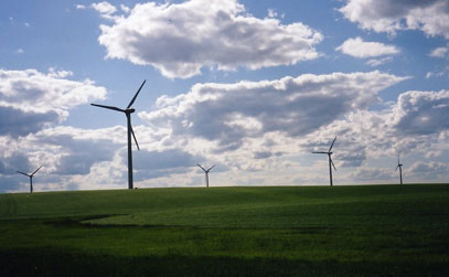 Windmills with a cloudy sky