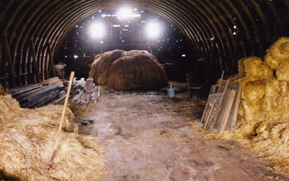 A barn interior filled with hay
