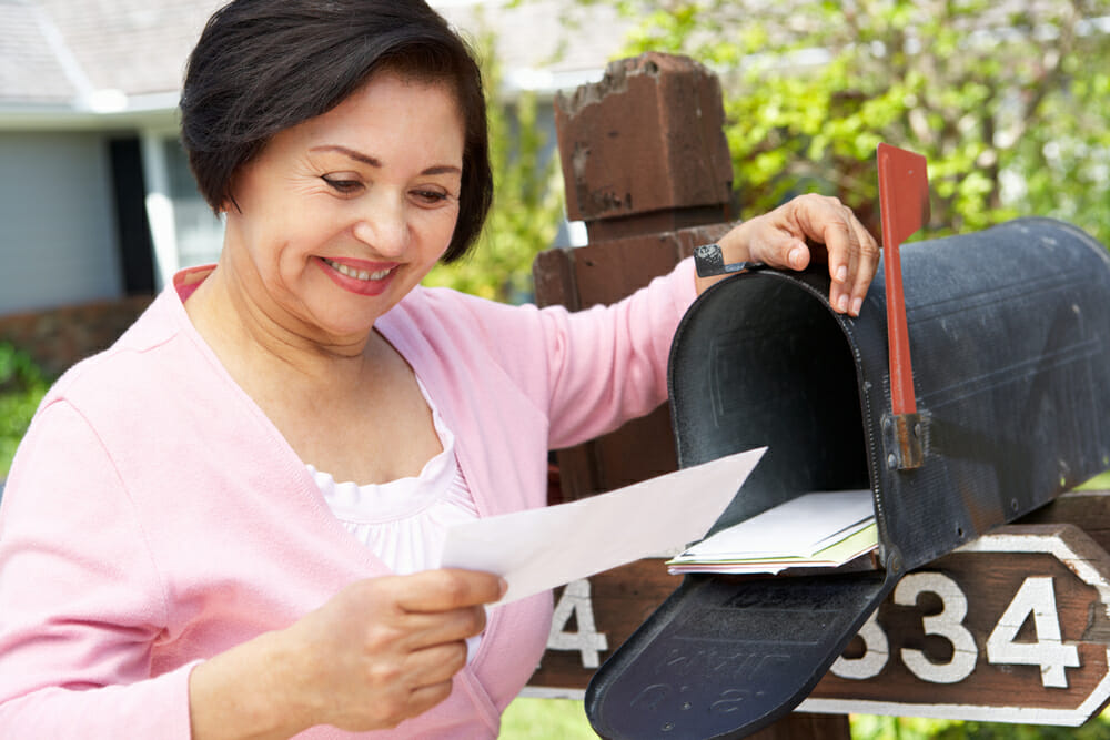 Senior woman checking mailbox
