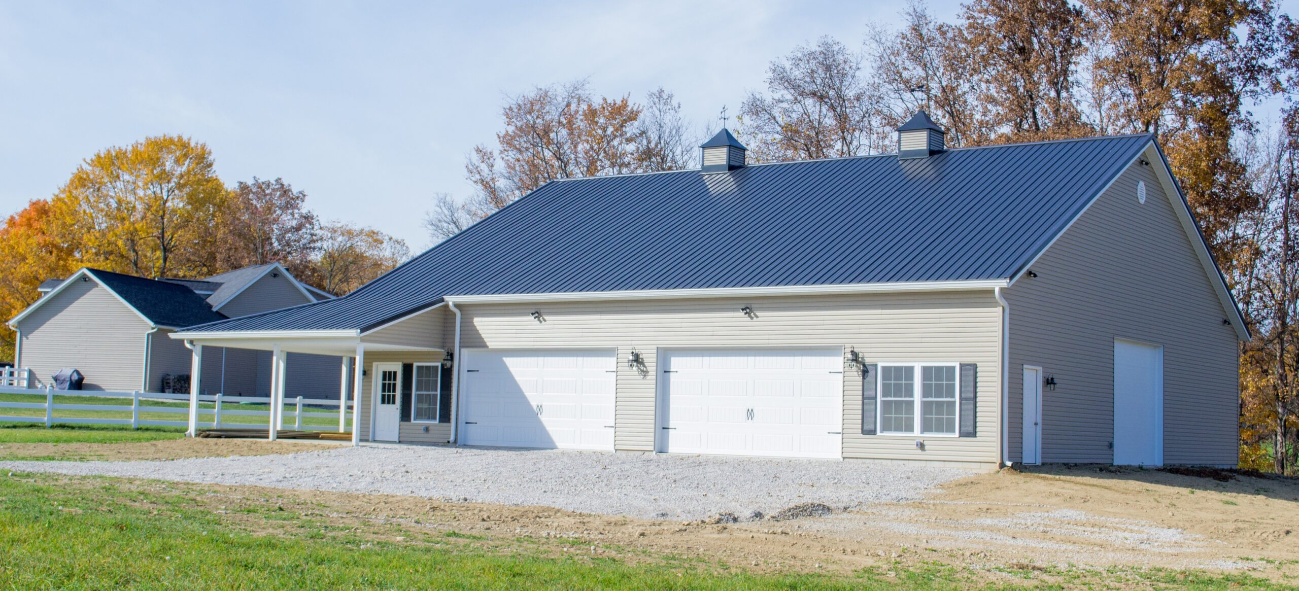 Pole Building Tan Siding with Black Shutters Built by Yoder Barn