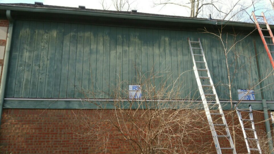 Replace old wooden siding